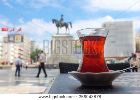 Ankara, Turkey - Drinking Turkish tea at Ulus Square  which is the oldest one and hosting historical Ataturk statue.