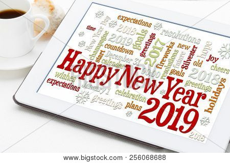 Happy New Year 2019 greetings card  - word cloud on a digital tablet with a cup of coffee