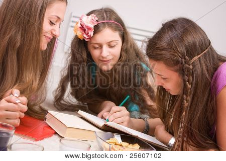 Young girls writing notes and having fun