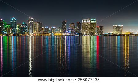 San Diego Skyline, Night, Water Reflections. Downtown Cityscape With Buildings Reflecting, City Of S