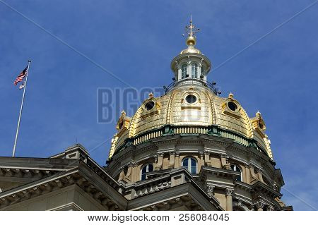 The Iowa State Capitol dome gleams in the sunlight. The beautiful dome has stood over Des Moines since 1886. poster