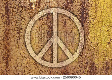 Sign of peace on a rusty metal background