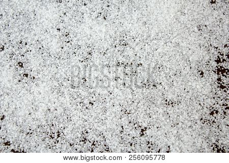 Crystals Of Sugar On The Table Surface