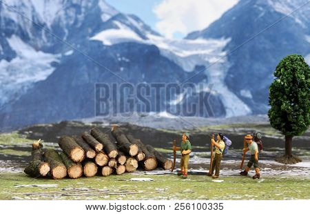 Men On Mountain Mountaineering And Mountain Hiking Up In The Mountains With Blue Skies And Good Weat