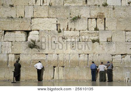 men praying next to the wailing wall, jerusalem,israel