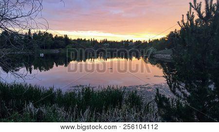Beautiful sundown around Beaumaris Lake, Edmonton's largest stormwater pond, in Alberta, Canada poster