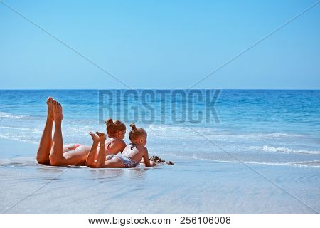 Happy Family Lifestyle At Beach Sea Surf. Little Child, Young Mother In Bikini Relaxing On White San
