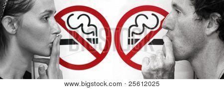 couple smoking a no smoking sign