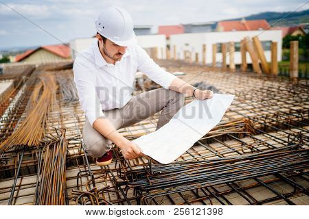 Engineering Details - Civil Construction Engineer Working On Building Site
