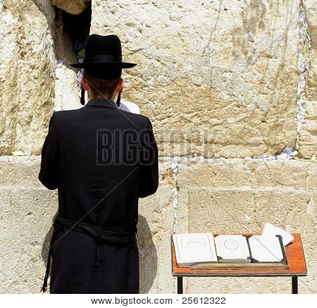 young hasidic jew at the wailing western wall, jerusalem, israel poster