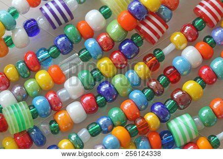 Murano And Venetian Glass Handmade. Bright Colorful Beads Of Murano Glass. Bright Background Of Glas