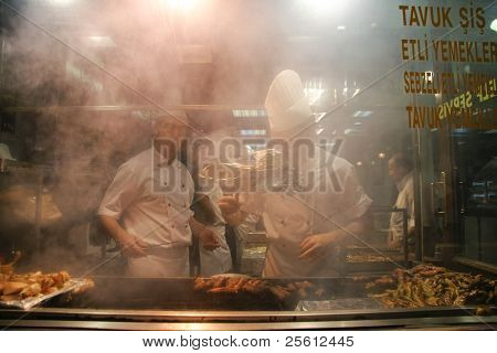 ISTANBUL - JULY 25 : Cooks prepare food in busy pedestrian area of Taksim in Istanbul, Turkey on July 25, 2007. Istanbul generates 21.2% of Turkey's gross national product.