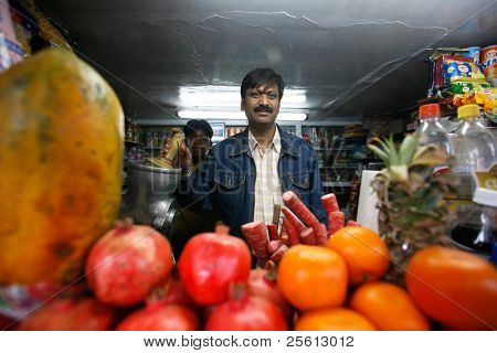 DELHI - FEBRUARY 26: Juice stall owner preparing fresh fruit juices on February 26, 2008 in Dehli, India. Fresh juices are great alternatives to polluted drinking water in India.