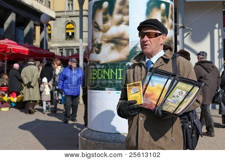 ZAGREB - MARCH 6: Jehovah witness selling religious literature on Ban Jelacic square on March 06, 2010 in Zagreb, Croatia. The religion has worldwide membership of over 7 million