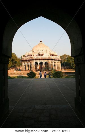 DELHI - FEBRUARY 11: View through archway to people in gardens at Humayun Tomb on February 11, 2008 in Delhi, India. Declared a UNESCO World Heritage Site in 1993.