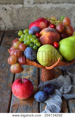 Autumn Still Life For Thanksgiving With Autumn Fruits And Berries On Wooden Background - Grapes, App