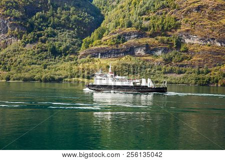 Flam, Norway-august 16, 2014 -  Cruis Ship With Passengers In Naeroyfjord.