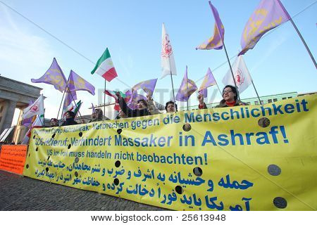 BERLIN - NOVEMBER 3: Iranian demonstrators in front of US embassy on Parizer Platz on November 3, 2011 in Berlin, Germany. Protesters want the US to protect Irani refugees inside Ashraf Camp, Iraq.
