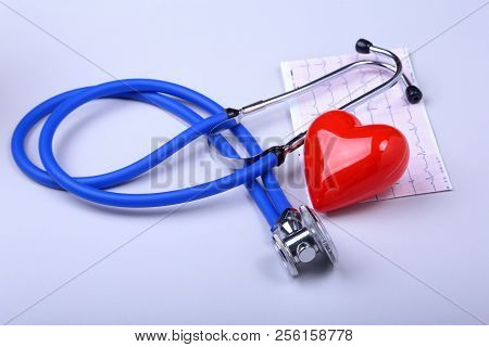 Stethoscope, Rx Prescription, Red Heart And Assorted Pills On White Table With Space For Text.
