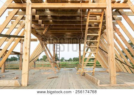 Low Angle View Of Framing Members In Wood Frame Home Under Construction At Sunset, Shagany Lagoon, U