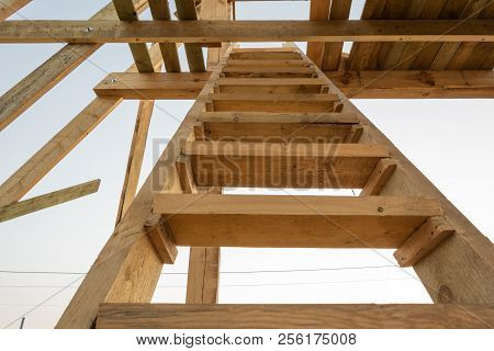 A Staircase To The Roof Of A Timber Frame House At Sunset. Construction Of A Frame House In Ukraine.