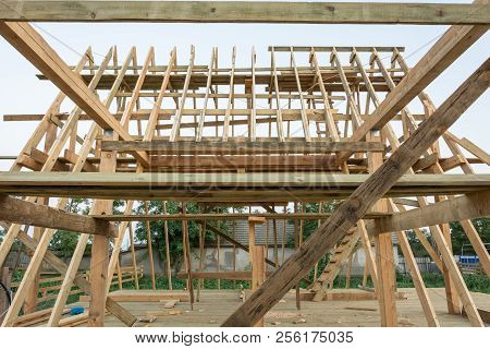 Rafters Of The Frame Of A Wooden House At Sunset. Construction Of A Frame House In Ukraine.