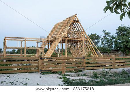 Wood Frame Residential Construction Site At Sunset, Ukraine.