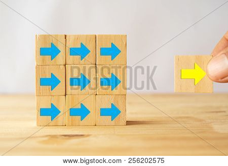 New Trend Concept, Hand Move Forward The Yellow Arrow As Gold Goal Success Trend Leader Which Follow