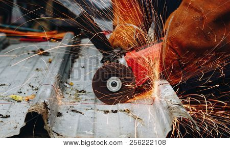 Industrial Worker Cutting Aluzinc Metal Sheet . Worker Cutting Aluzinc Metal Sheet At Building Site