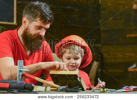 Boy, Child Busy In Protective Helmet Learning To Hammering Hobnails With Dad. Masculine Duties Conce