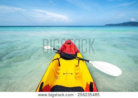 Colorful Kayak On The Tropical Beach With Blue Sky At Cock Burn Island, Myanmar