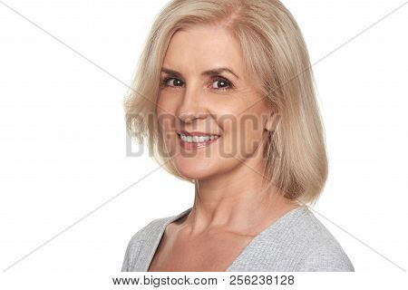 Beautiful Old Lady Presenting A Product. Pretty Smiling Senior Woman Isolated On White
