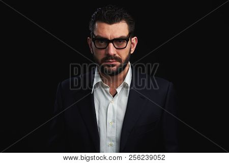 Handsome Bearded Man In Fashionable Clothes And Glasses