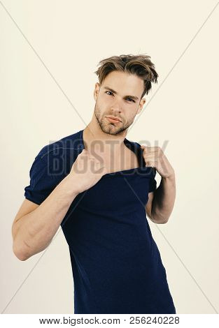 Macho With Seductive And Confident Face Tears His Clothes. Masculinity, Temptation And Confidence Co