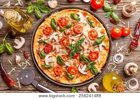 Flat Lay With Italian Pizza On Wooden Board And Various Ingredients
