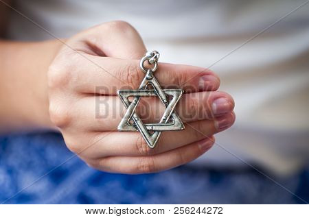Hand Of A Young Woman Holding A David Star Key Chain. The State Of Israel, Judaism, Zionism Concept