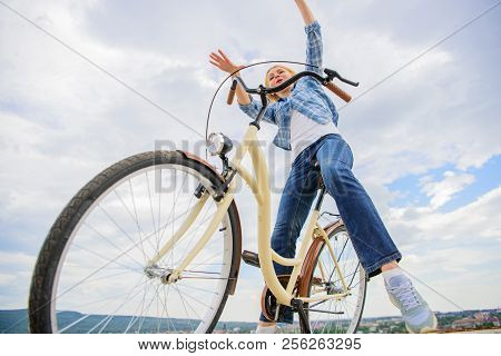 Freedom and delight. Most satisfying form of self transportation. Cycling gives you feeling of freedom and independence. Girl rides bicycle sky background. Woman feels free while enjoy cycling. poster