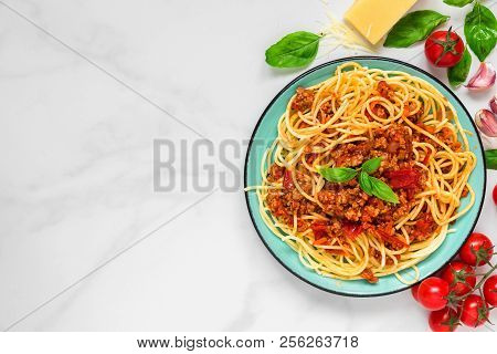 Pasta Spaghetti Bolognese On A Blue Plate On White Marble Table. Healthy Food. View From Above With