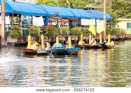 Samutsakorn, Thailand - July 27, Many People In Boat Parading Traditional Of Candles To Temple At Ka
