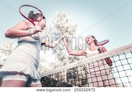 Cheerful Women Taking Part In Tennis Match