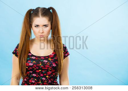 Education, Teenage Adolescence Concept. Angry Teenager Student Girl With Ponytails Having Brown Hair
