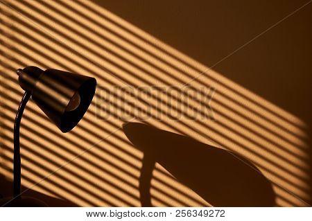 Morning Sunlight Coming Through The Window Through Venetian And Sun-lighting A Lamp And Creating Sun