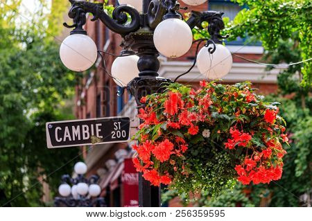 Cambie Street Light And Sign With Hanging Flower Basket In The Heart Gastown, Touristy Heritage Dist