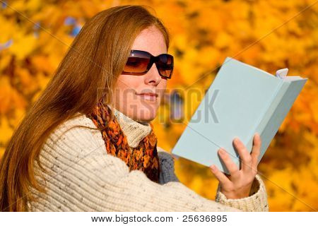 Autumn sunset country - red hair woman read book