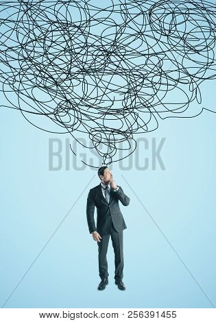 Confused Young Businessperson With Scribble. Confusion And Think Concept
