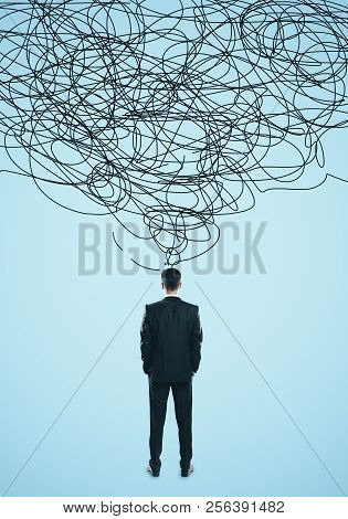 Confused Young Man With Scribble. Confusion And Think Concept
