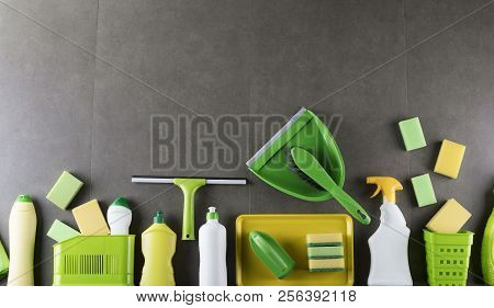 House And Office Cleaning Up Theme.  Set Of Colorful Cleaning Products On Gray Tiles  Background. To