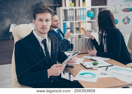 Three Elegant Classi Business Sharks In Boardroom. Handsome Expert Checking, Reading Report, Holding
