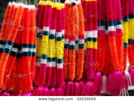 A bunch of artificial garland in an indian bazaar.