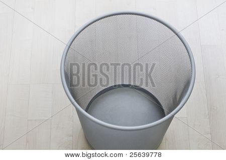 A top view of an empty trash can